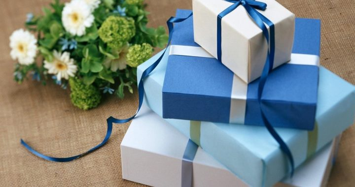 blue gifts wrapped stacked on top of each other